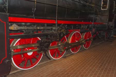 Russia, Saint-Petersburg, 15, Nov 2017 - wheels and pistons of a steam locomotive in the railway Museum