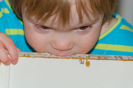 a kid eating a small chair