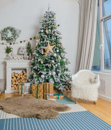 living room in Christmas style with a decorated Christmas tree and a fireplace