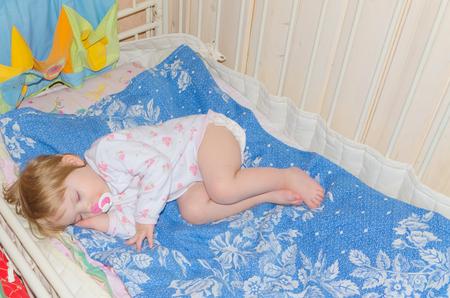 in the crib sleeping sweet baby