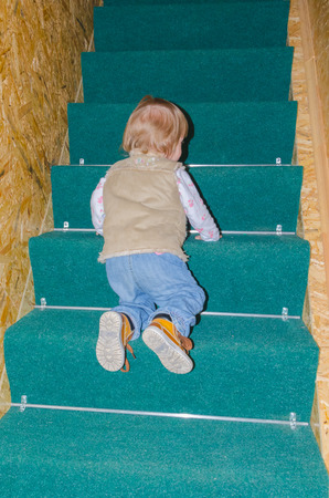 the child up the stairs in the house