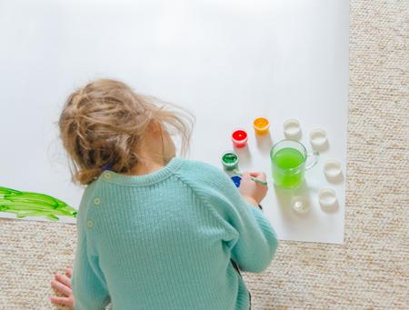 sitting on the floor, paints, girl