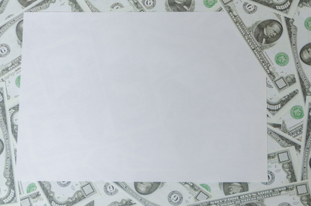 on the background of money on the sheet, place the graphic Фото со стока