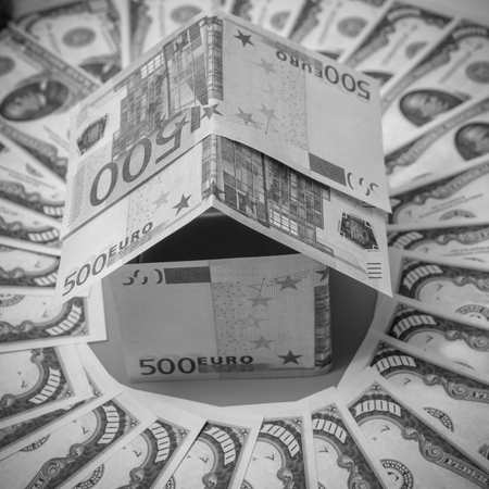 house made of Euro banknotes, in a circle dollar