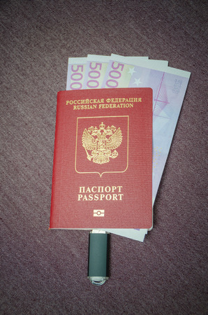 the passport of the citizen of the country with the money the Euro is the connected memory card Stock Photo