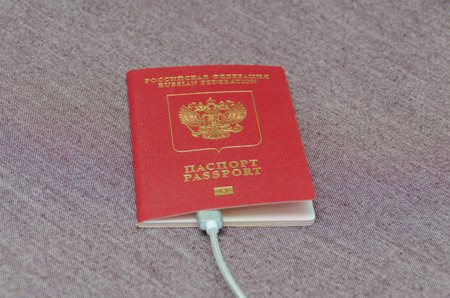 is the passport of the citizen of the country, on a fabric texture Stock Photo