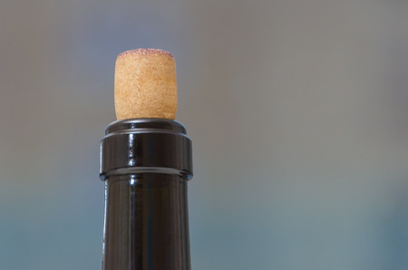 closeup of the neck of a wine bottle closed with cork background