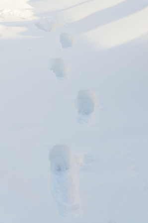 close-up, human footprints in deep snow