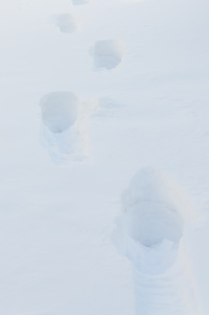 close-up, in the deep snow traces of a human