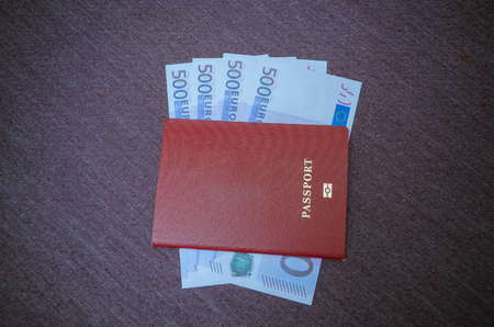 under the passport the notes are Euro bribe