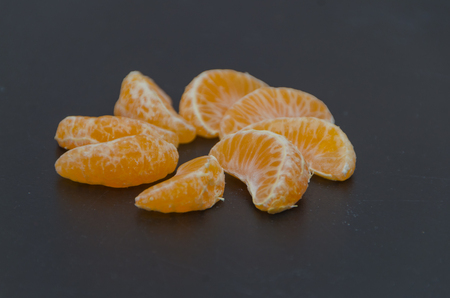 on a black background of Mandarins share in the form of a circle