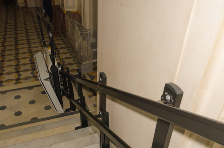 electric lift for wheelchair users in the transition to the stairs 스톡 콘텐츠