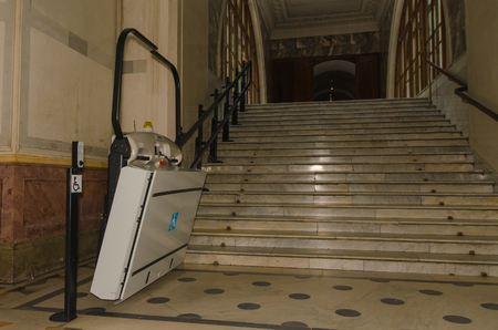 electric lift for wheelchair users in the transition to the stairs Banco de Imagens