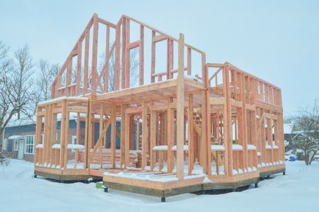 construction of frame wooden house in winter