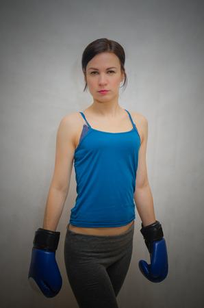 slim, sporty girl in Boxing gloves