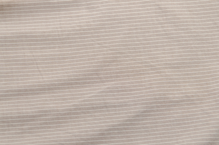 background, beige fabric with white stripes, texture Stock Photo