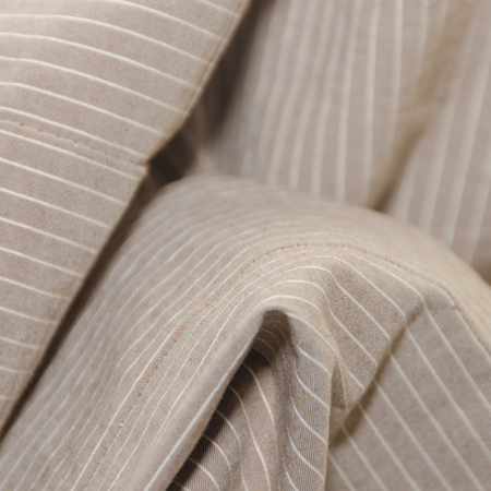 background, crumpled beige fabric with white stripes, texture Stock Photo