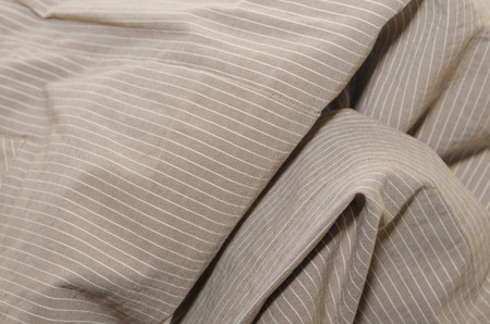 texture, crumpled beige fabric with white stripes, background