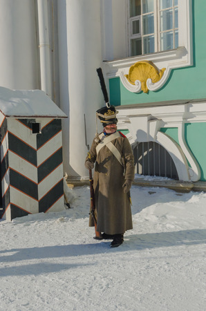 Russia, Saint Petersburg, February 27, 2018-reconstruction, guard post at Palace square, Russian soldier in the form of Alexander the great