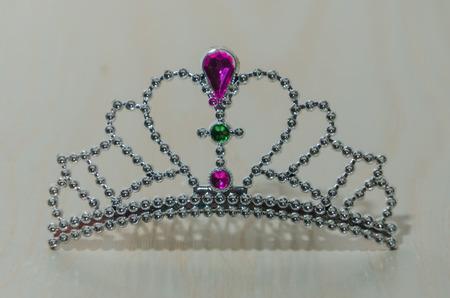 on a white Board toy plastic tiara Stock Photo