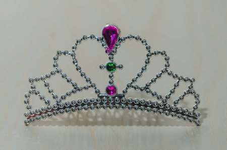 on a white Board toy plastic tiara Banque d'images