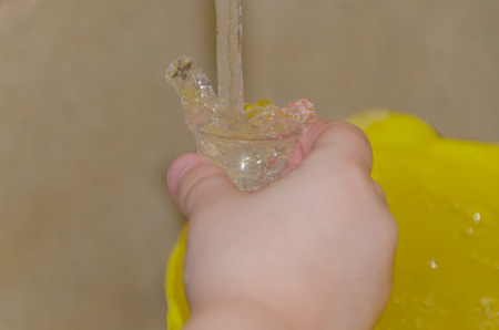 the child collects water in a small Cup