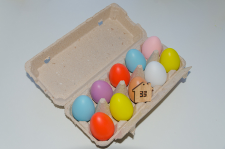 wooden house toy and multicolored Easter eggs