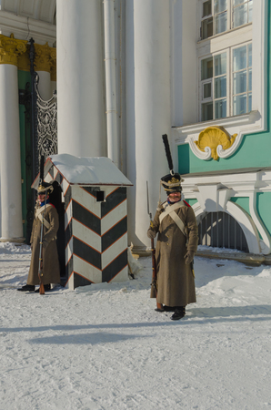 Russia, St. Petersburg, February 27, 2018-reconstruction, Russian soldier in the form of Alexander the first time, guard post at the Hermitage Stock Photo - 98390012