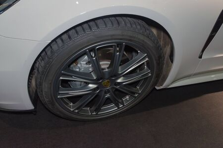 Russia, Saint-Petersburg, 13 April 2018 - wheel of the Porsche, the world car exhibition in SKK. Editorial