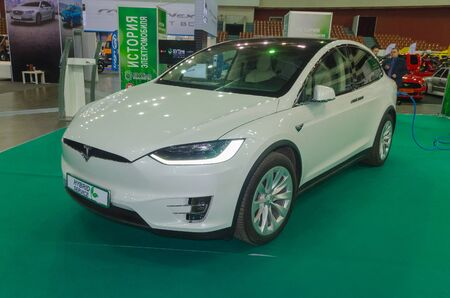Russia, St. Petersburg, April 13, 2018-hybrid electric Tesla model  X on charging, at the exhibition world of the car in SKK. Editorial