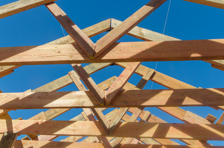 the frame of a wooden house, roof slabs of boards