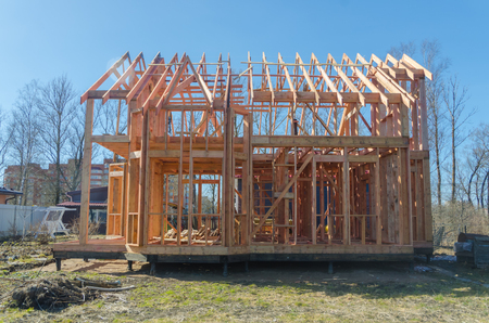 the frame of a wooden house made of boards and timber treated with fire protection