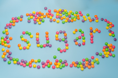 candy, caramel sugar posted diet, on a blue background closeup 写真素材