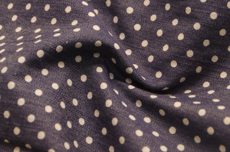 close-up, natural fabric texture with pea pattern, white circles on dark blue Stock Photo - 100158528