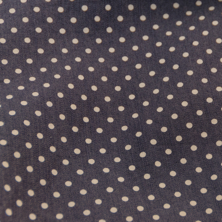 close-up, natural fabric texture with pea pattern, white circles on dark blue