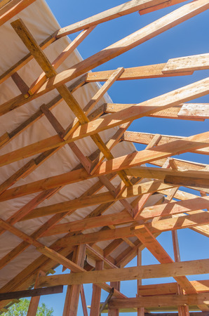 construction frame house made of wood, with roof rafters metal, profiled Stock Photo