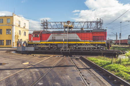on a Sunny day, a freight electric locomotive on a turning circle in the depot Фото со стока