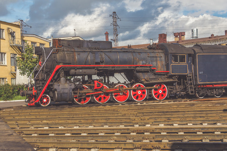 old steam locomotive on the street on the railway tracks Banco de Imagens