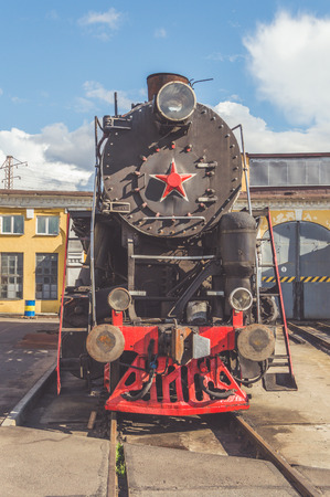 steam locomotive on rails front view Standard-Bild - 102259480
