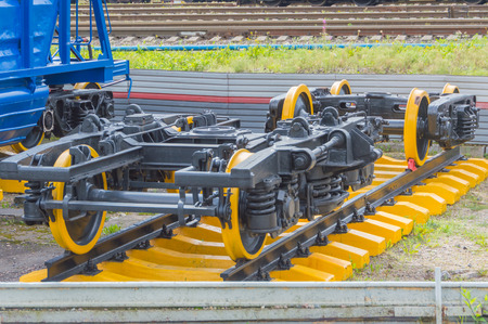 newly painted railway wheel pair on rails