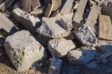 close-up of stones and firewood piled together