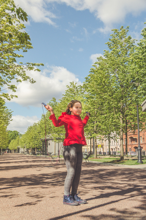 child, a girl in the Park jumping rope