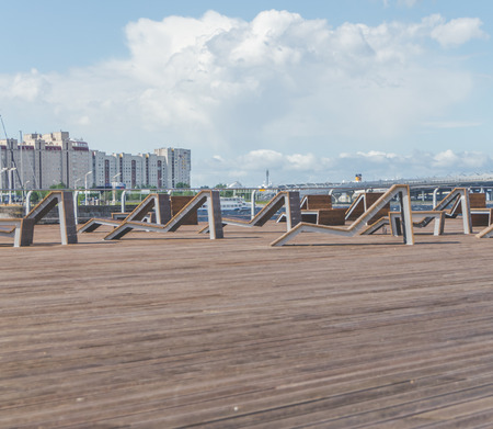 on the beach wooden promenade with benches