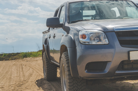 off-road car on desert sand road Stock Photo - 104124313