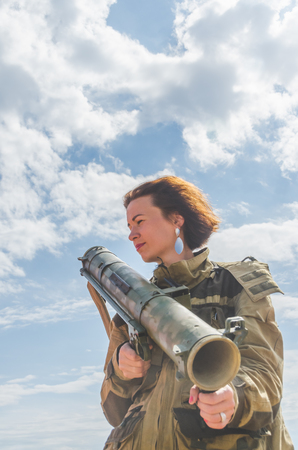 on a Sunny summer day a girl in uniform with a Bazooka