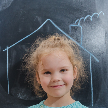 the girl in the house which is drawn on the chalkboard, storm, rain