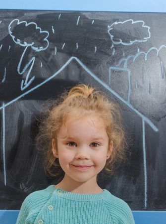 the girl in the house which is drawn on the chalkboard, storm, rain Stok Fotoğraf - 104568876