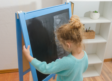 the girl, a student of the pure chalk Board