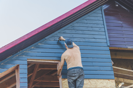 summer day wooden house painting worker