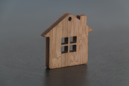 toy, wooden house on black background